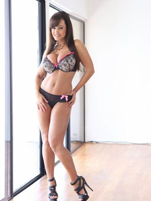 Pure Mature - Irresistible milf Lisa Ann removing skimpy lingerie and showing off boobs