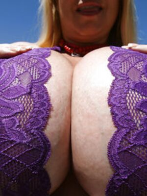 Freaks of Boobs - Busty mature babe Samantha 38G playing with her melons outdoor