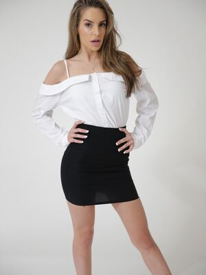 Passion-HD - Solo model Kimmy Granger strips off black miniskirt om way to posing nude